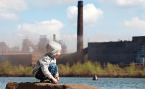 Industrial landscape with playing boy