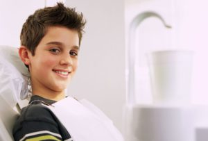Smiling boy in dentist's chair